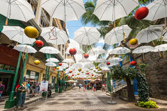 White umbrellas in Caudan Waterfront Mall Stock Image