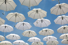 White umbrellas flying in the sky Royalty Free Stock Images