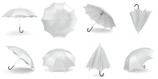 White umbrellas and parasols in various positions open and folded collection. 3d rendering Stock Images