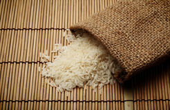White uncooked rice in small sack Royalty Free Stock Photos