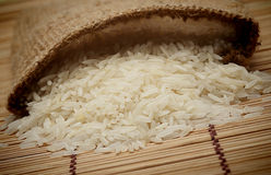 White uncooked rice in small sack Stock Photo