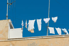 White underwear drying on rooftop clothesline Royalty Free Stock Photo