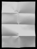 White uneven sheet of paper on the black background Stock Photo