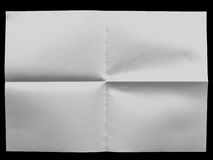 White uneven sheet of paper on the black background Royalty Free Stock Image