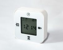 White universal desk clock alarm clock, also showing days of the Stock Image