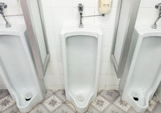 White urinal Stock Photos