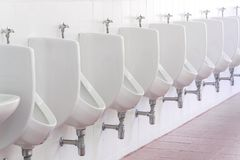 White urinals ceramic men public toilet.  Royalty Free Stock Photos