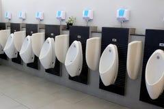 White urinals. Stock Photo