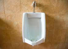 White urinals of the men`s toilet royalty free stock photography