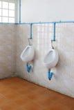 white urinals. Stock Photos