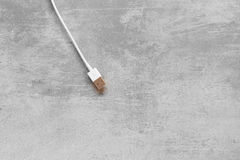 White USB cable on concrete background Royalty Free Stock Image