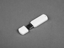 White usb flash drive on gray background Royalty Free Stock Photo