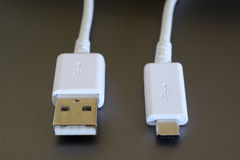 White USB and micro USB plugs Royalty Free Stock Image