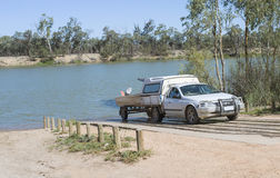 White Ute and Trailor at Boat Ramp. Royalty Free Stock Photos