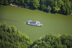 White vacation ferry on trip on the river with beautiful forest Royalty Free Stock Photos