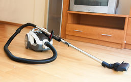 White vacuum cleaner on  parquet Stock Image