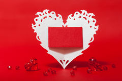 White Valentines lace heart with card Stock Image