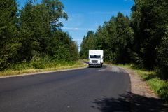 White van on the asphalt road. royalty free stock photography