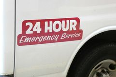 24 Emergency Service. A white van with the message 24 hour emergency service Royalty Free Stock Photo