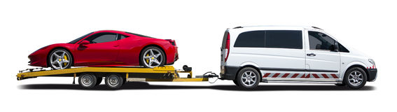 White van towing sport car. White van towing Ferrari, side view isolated on white stock image
