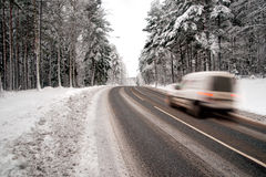 White van on winter road Stock Photos