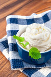 White vanilla ice-cream with green mint leaf royalty free stock photography
