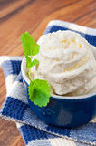 White vanilla ice-cream with green mint leaf Royalty Free Stock Photos