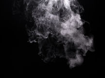 White vapor cloud of electronic cigarette. On black background Stock Photography
