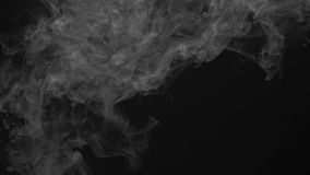 White vapor smoky cloud of cigarette. White smoky cloud of electronic cigarette on black background stock video footage
