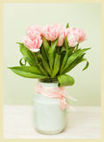 White vase with a bouquet of pink tulips Royalty Free Stock Photo