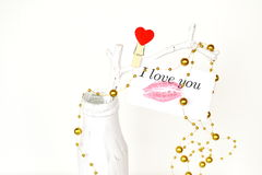 White vase with branch and card with lipstick kiss and the words I love you. Wedding, Valentine's day background Stock Photo