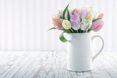 White vase with colorful tulips Stock Photo