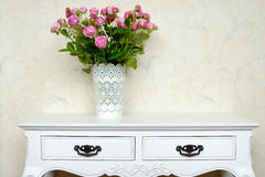 White vase full of pink roses Royalty Free Stock Photography