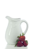 White Vase and Strawberries. White ceramic vase with lace detail and strawberries Stock Image