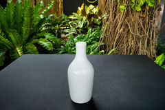 White vase on table Royalty Free Stock Images