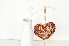 White vase with wooden branch and fabric heart decoration. Valentine's day background. Valentine's day composition Royalty Free Stock Photos