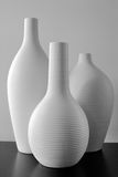 White Vases. On a black countertop Royalty Free Stock Photo