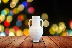 White Vases on the table. Circular bokeh background royalty free stock photos