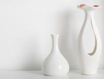 white vases on white shelf royalty free stock images