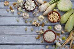 White vegetables and fruits on a wooden background - currant, cauliflower, champignons, radish, parsley, mushrooms, garlic. Onion,. White vegetables and fruits Royalty Free Stock Photo