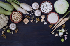 White vegetables and fruits on a wooden background - currant, cauliflower, champignons, radish, parsley, mushrooms, garlic. Onion,. Cabbage, mulberry, rice Stock Photos