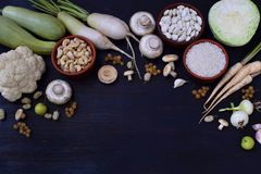 White vegetables and fruits on a wooden background - currant, cauliflower, champignons, radish, parsley, mushrooms, garlic. Onion,. White vegetables and fruits Royalty Free Stock Photos