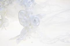 White veil. Detail of white wedding veil with headdress.Over white Stock Photos