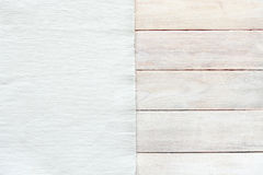 White velvet material and grunge wood board texture background. Surface of aged white wooden planks and striped texture fabric, top view, empty place Stock Image
