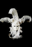 White Venetian carnival mask. A face pack with feathers Royalty Free Stock Images