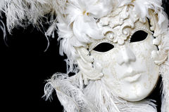 White Venetian carnival mask. A face pack with feathers. Luxury royal mask Stock Photo