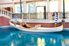 White venetian gondola on blue water Stock Image