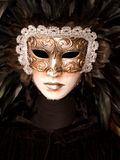 White venetian mask with black feathers Royalty Free Stock Photo