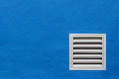White Vent on Blue Concrete Wall, . White Vent on Blue Concrete Wall Stock Images