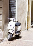White Vespa  scooter on the street in Italy Stock Photos